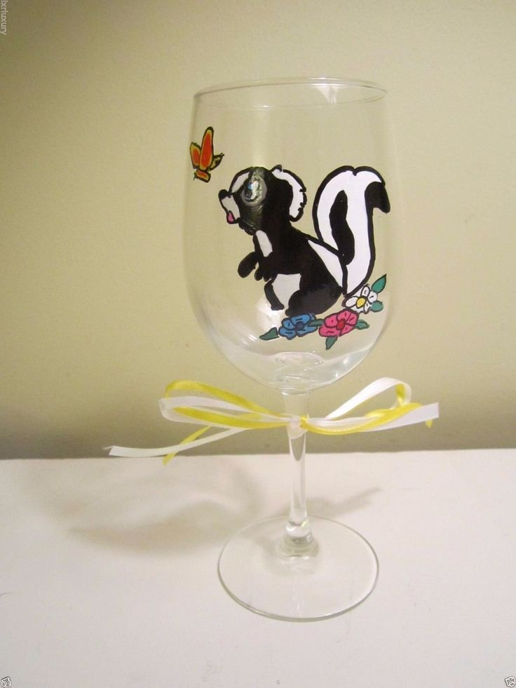 Painted Wine Glass FLOWER SKUNK friend of Bambi Chasing a Butterfly 12 ozz. Friend of Bambi 12 oz. Wine Glass Black and White Skunk Yellow and Orange Butterfly Sitting in a Garden of Pink, Yellow and White Flowers No 2 will be exactly the same My Wine Glasses are all Hand Painted - there will be no 2 exactly alike. The harsh chemicals and high temperatures of a dishwasher can damage the paint. We recommend gentle hand washing.