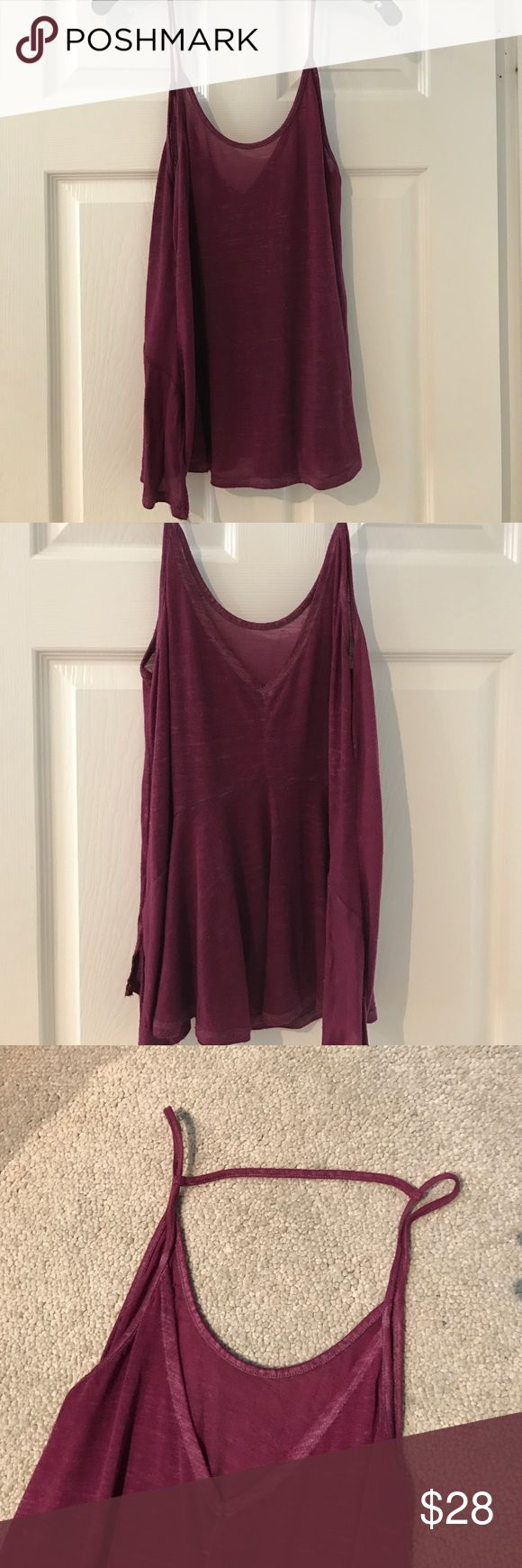 Purple Cami from free people. Flares at bottom with slits in the side. New condition. Curved neckline with v cut in the back spaghetti straps. Light material. Free People Tops Tank Tops