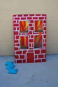 Fire Fighter Birthday Party games - water beanbag through flaming window