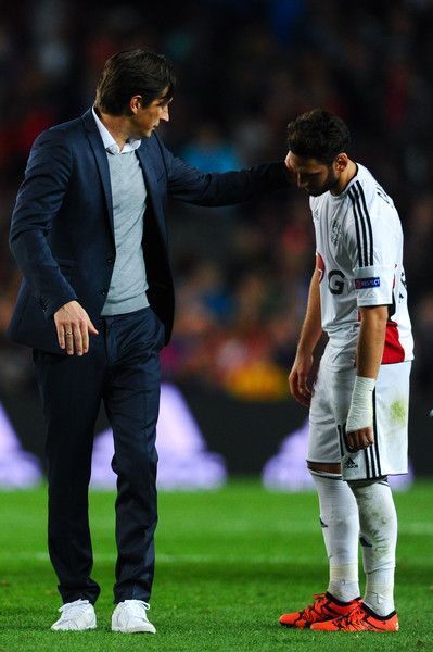 Head coach Roger Schmidt of Bayern 04 Leverkusen comforts his players Hakan Calhanoglu of Bayer 04 Leverkusen at the end of the UEFA Champions League Group E match between FC Barcelona and Bayer 04 Leverkusen on September 29, 2015 in Barcelona, Catalonia.