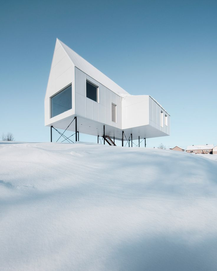 Stilts Elevate This Small Winter Cabin By Delordinaire Above A Snow Laden  Slope In Quebec