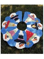 Time to start making your Christmas quilted tree skirt with Santa and friends.