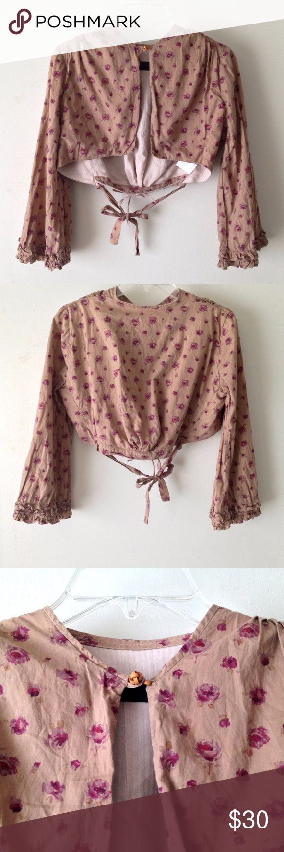 Allsaints Crop Jacket Bolero, size 8 -- AllSaints Crop Jacket / Bolero -- Condition: regular wear and tear, some fading from laundering Color: Beige with magenta floral pattern  Size: US 8 / UK 10 / EU 38  - Flared ruffled sleeves - Lined bodice - Leather lattice button - Ties to adjust fit - Pleating  Length: ~ 13 inches Sleeve Length: ~ 19 inches Armpit to armpit: ~ 19.5 inches All Saints Jackets & Coats
