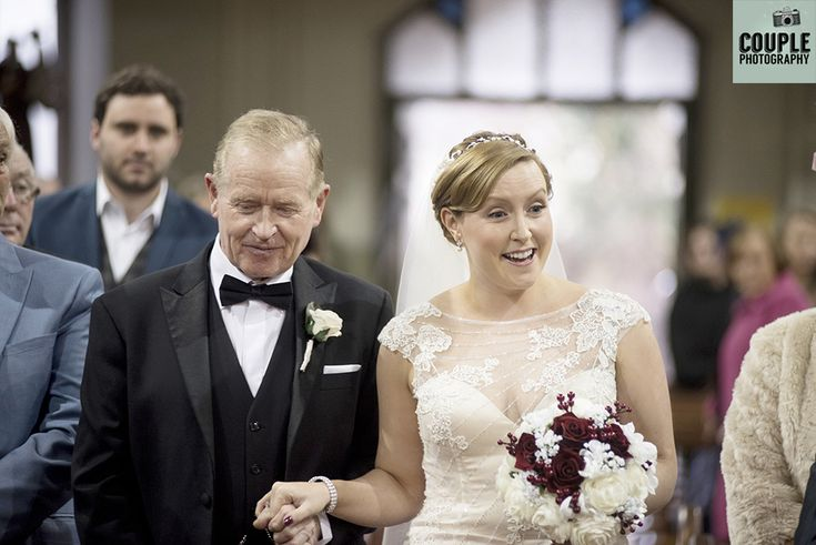 The bride & her father walk down the aisle of the church. Weddings at Thomas Prior Hall, The Clayton Hotel by Couple Photography.