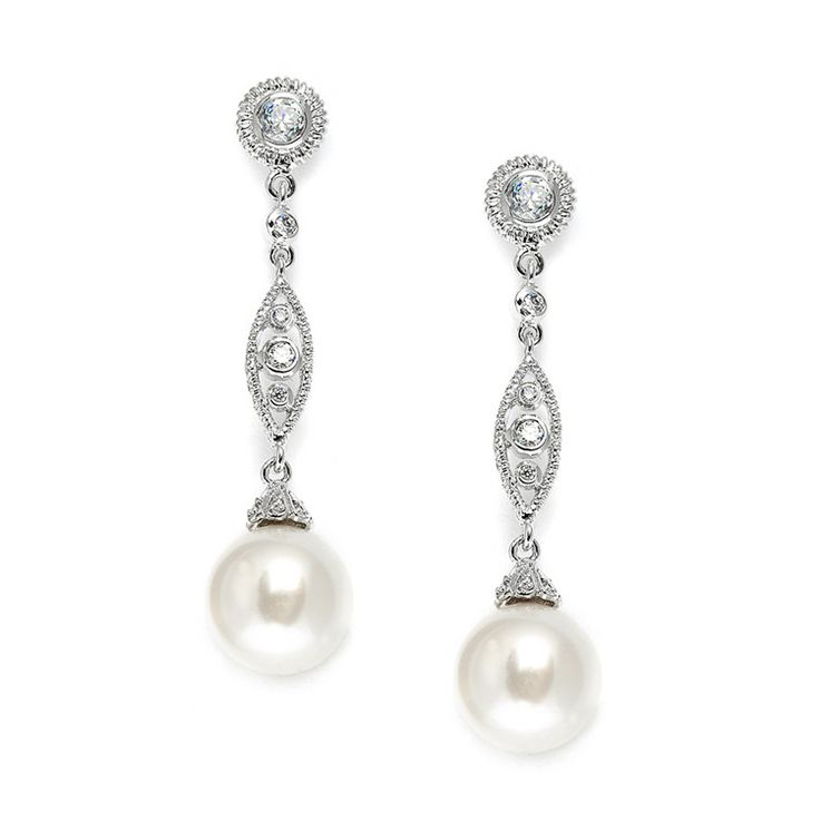"These irresistable rhodium plated 1 7/8"" Mariell Wedding Earring are chic and well-priced! They have a shimmering textured bezel set CZ stud with a modern filigree dangle and a 12mm soft cream pearl d"