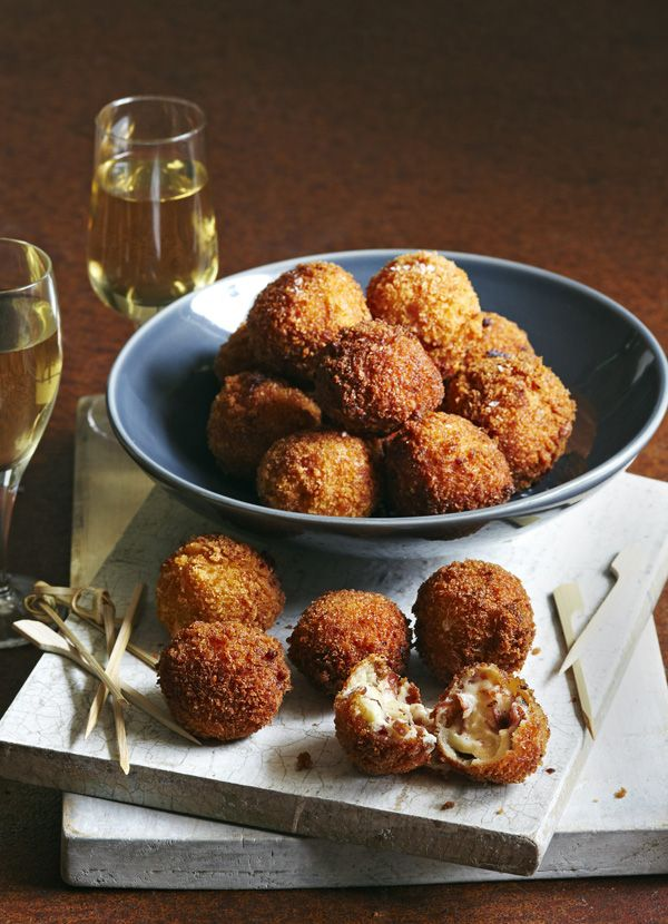 Ham croquetas. Bite-sized balls of deliciousness. These little Spanish tapas make excellent nibbles. Filled with manchego and ham, this simple-to-follow recipe makes them an easy treat.