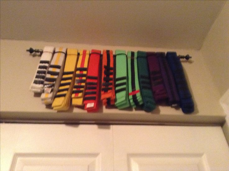 Karate Belt racks were $90 online.... So I bought a $3 towel bar from the dollar store and used it as a belt rack for Jayden's belts