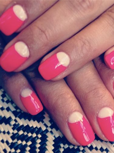 Shay Mitchell shows off her bright pink reverse French manicure