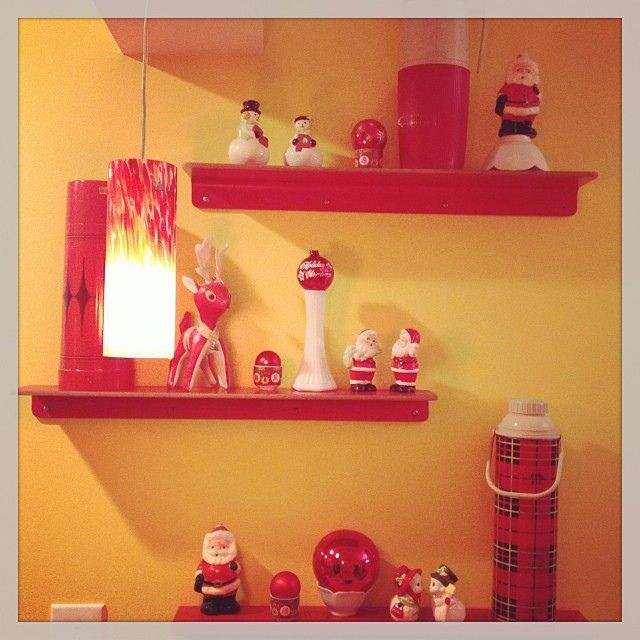 Modern June's kitchen vignette #vintage #saltandpeppershakers #thermoses and my very sad collection of #Santa candles! #mymomneeds...