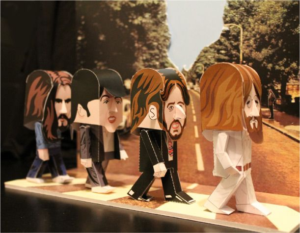 in commemoration of George Harrison's 70th Birthday today, here  are cute DIY Beatles papertoy cut-outs by Gary Willis!