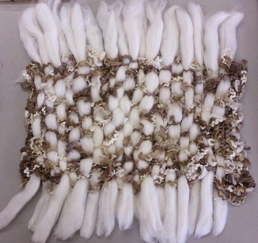 Experimental Textiles - session 5 - Constructed Textiles. (actually rovings woven through a knitted piece)