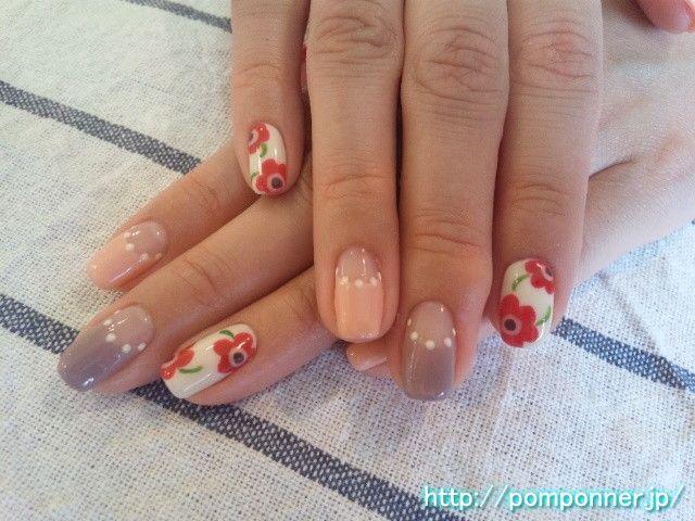 赤いマリメッコ風ネイル (Marimekko red flower blown by wind)