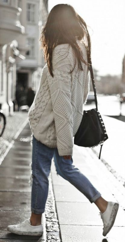 Knitwear and jeans + winning combination + Monja Wormser + cute and winter-ready + cream cable knit sweater + rolled denim jeans Knit: Only, Jeans: Sheinside, Sneakers: Axel Arigato.