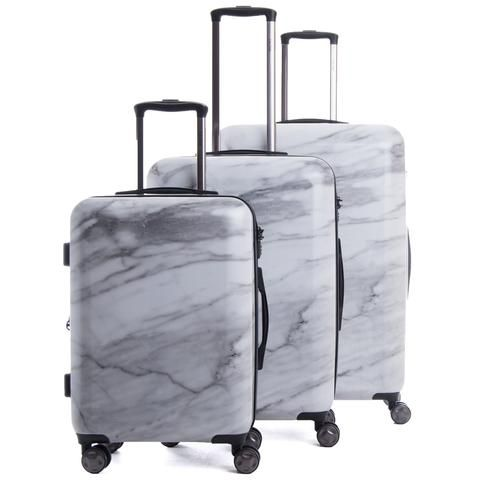 Calpak Milk Marble suitcases, perfect for looking chic while Travelling