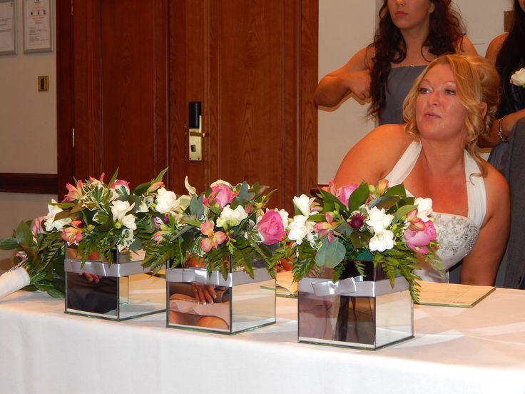Registry table-mirrored vases with silver ribbon wrap