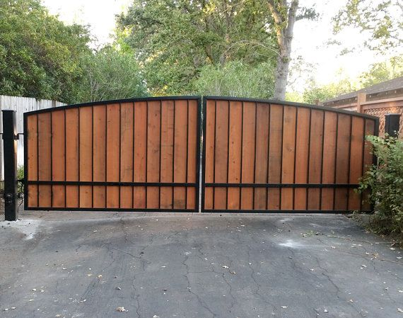 Dual Wrought Iron And Wood Driveway Gate With Posts And