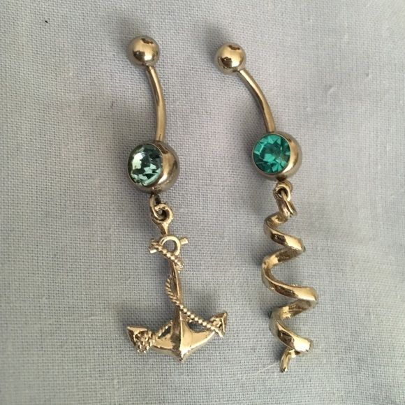 Belly button ring bundle  Two new never worn belly button rings! Bought with intent on wearing but unfortunately I don't like the way dangly jewelry fits. Hot Topic Jewelry