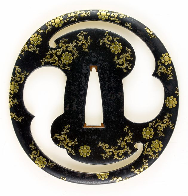 "A gold-inlaid tsuba, having the scattered family crests called ""Kuyou-Mon"" 九曜紋"