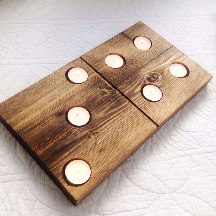 """There is something about reclaimed wood that instantly makes you feel cosy  Then when you add cosy candles what more could you ask for  These are perfect for a special occasion   Made from reclaimed scaffolding board and lovingly sculpted to a domino piece We then finish with a Danish oil Measuring 15"""" x 9"""" x 1.5"""""""