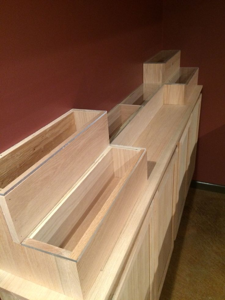 Liquor bottle display shelves. Next is to add led colored lights under glass