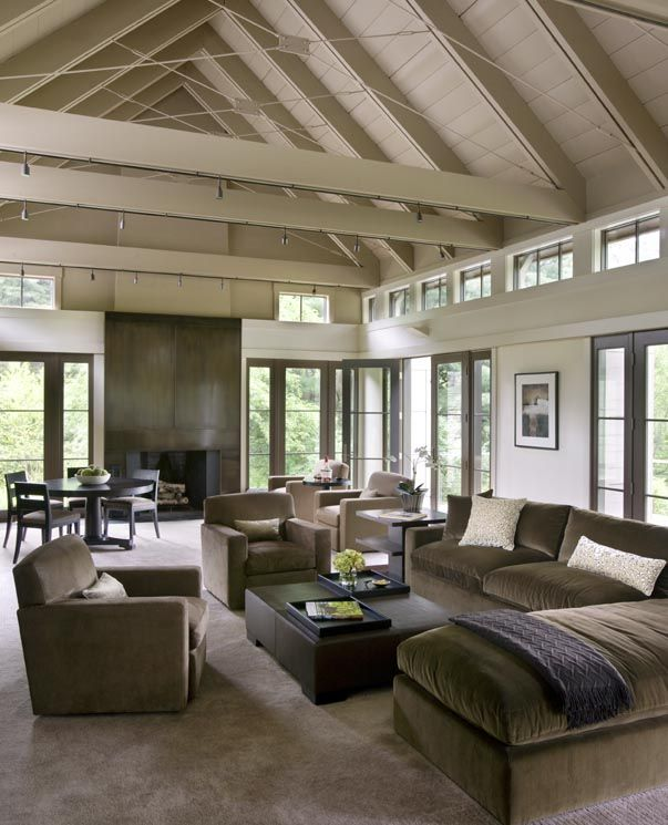Love the understated color scheme (mink and cream; french doors and windows with taupe trim; vaulted ceiling