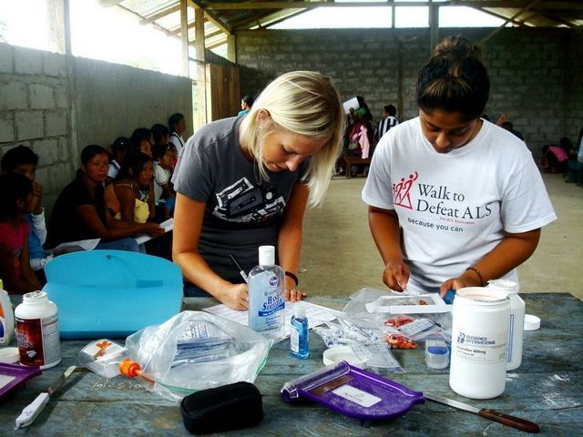 Lauren Butterbaugh, a volunteer pharmacist from Indianapolis, explains prescriptions in a Timmy medical clinic in Ecuador.