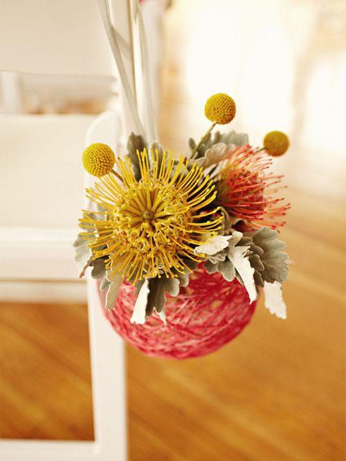 Cheap, DIY, Modern AND Beautiful? Yes Please! :  wedding ceremony diy flowers green inspiration orange pewters pink yarn balls yellow Yarnballaisledecor