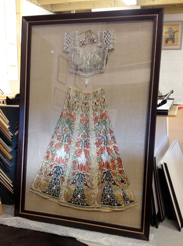 A Framed Indian Wedding Dress - I want this in my dream home. In a huge walk in closet, my wedding suit framed and hung up for display.