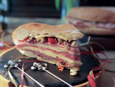 """Muffaletta with Olive Tapenade (When the Flavors Come Marching In) - Damaris Phillips, """"Southern At Heart"""" on the Food Network."""