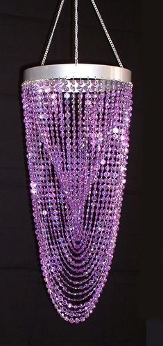 Iridescent Purple Diamond Tornado Twist Chandelier. I know this is a pre-made object, but it's given me so many ideas with the beads! I wasn't really thinking 'lamp', more of a pretty window sun catcher type of dangly decoration.