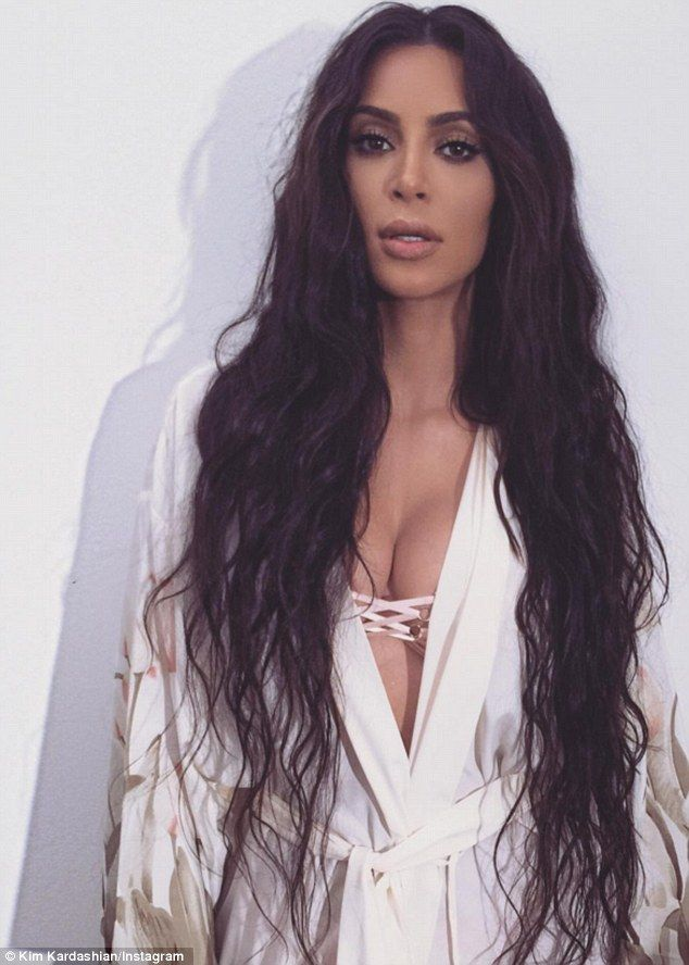 Hair story: Kim Kardashian showed off long locks on set of a photo shoot on Monday