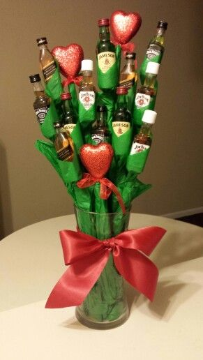 Liquor Bouquet....I don't like this look necessarily but interesting idea to wrap the bottles to look like flowers