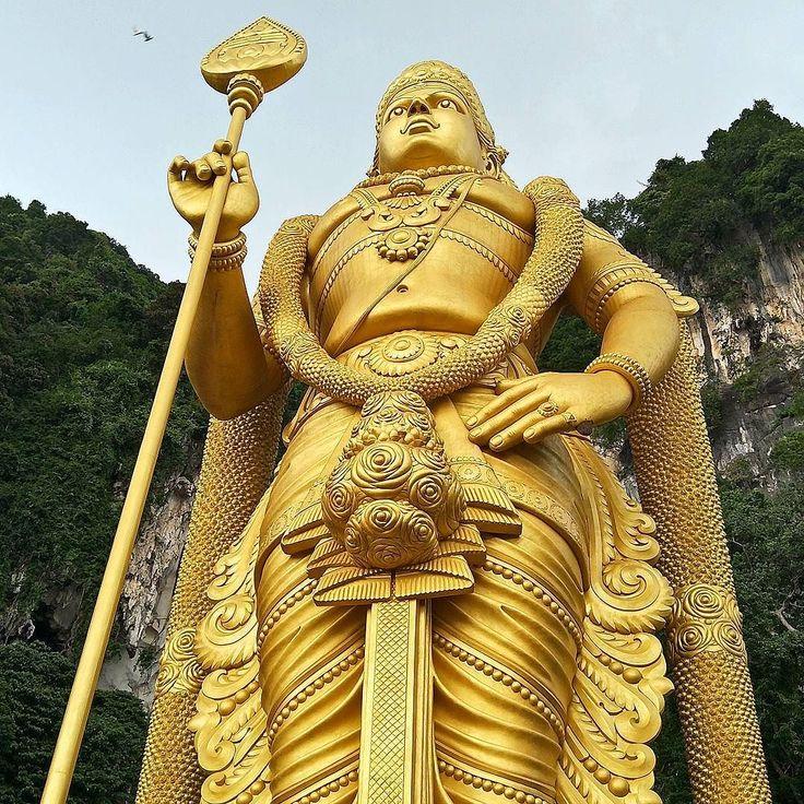 Malaysia Murugan: Lord Murugan Golden Statue From A Low Perspective At Batu