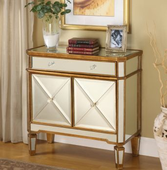 Hollywood glamour combined with functional storage, this mirrored accent cabinet will be a special addition to any home.