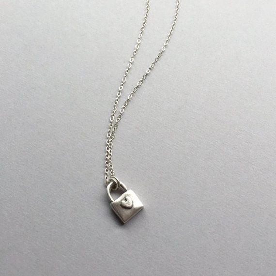 "Pure Silver Padlock handmade with love! This lil'cutie hangs on a sterling silver chain on your choice from 15""-17"". A classic modern style piece! ($60) #padlock #daintynecklace #charmnecklace"