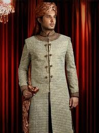sherwani design has given way to a more stylish cut and embroidered sherwani. Accompanied with a pagri (turban), juttis and a stole.