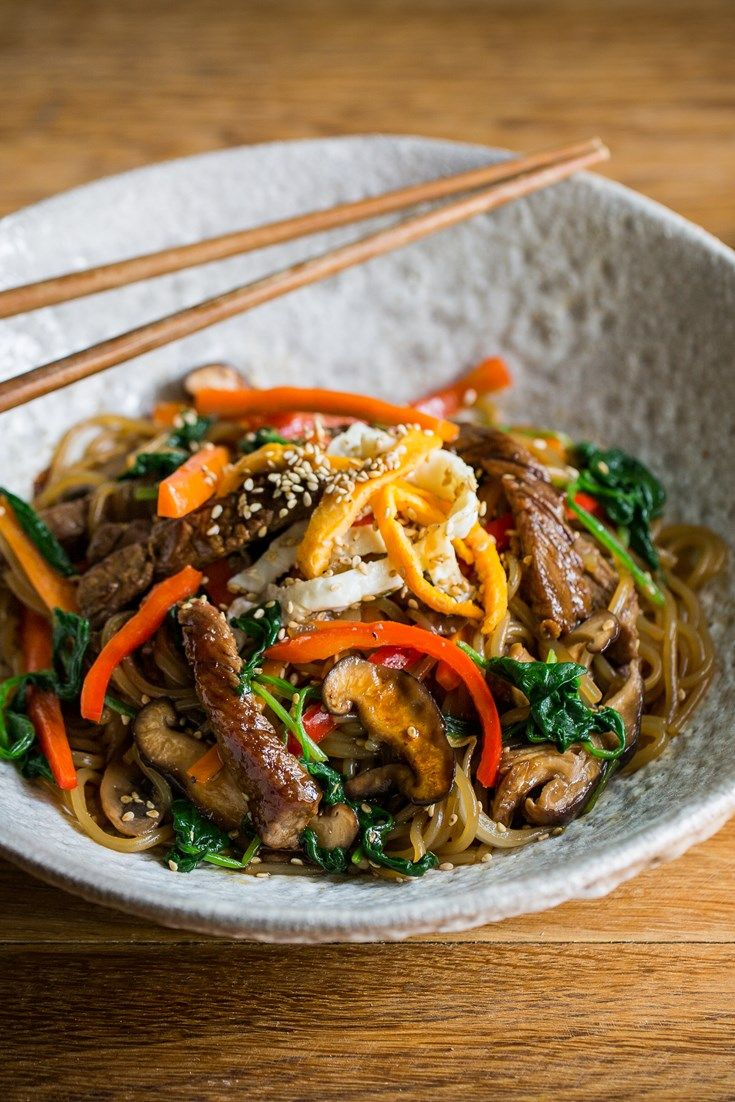 This stunning japchae recipe is a Korean classic, with toothsome sweet potato noodles mingling with perfectly cooked steak strips, mushrooms and spinach.