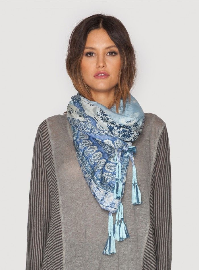 Pepin Scarf  The Johnny Was Collection Signature Silk PEPIN SCARF features a bold geometric border design accented by delicate floral motifs at the center, all in chic grey and blue hues. Try this printed silk scarf draped, knotted, or wrapped to add a boho luxe touch to any outfit!  - 100% Silk - Measures 43