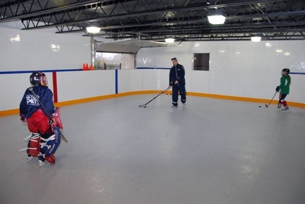 A synthetic ice rink in the basement?? Ummm... Awesome!!!