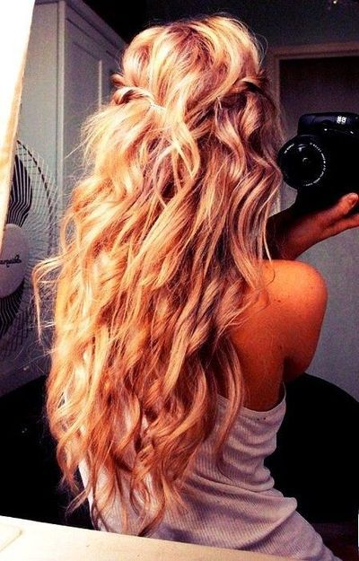 beach wedding hair, maybe with some little white flowers intertwined in the side twists/braids (: