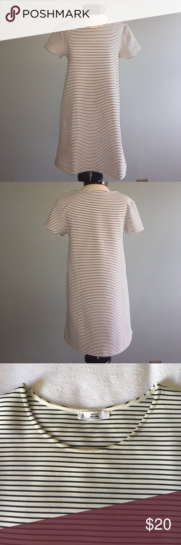 Mango Stripe Mini T-Shirt Dress Striped black and white mini dress by Mango. T-shirt style with short sleeves and slight bell shape. Great everyday dress with sneakers and a jean jacket! EUC! 💕 Mango Dresses Mini