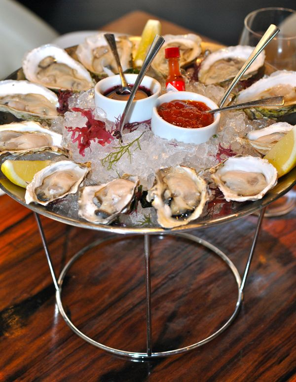 Oysters served with a selection of sauces: Cocktail sauce, Mignonette, and Llemon Dijonnais