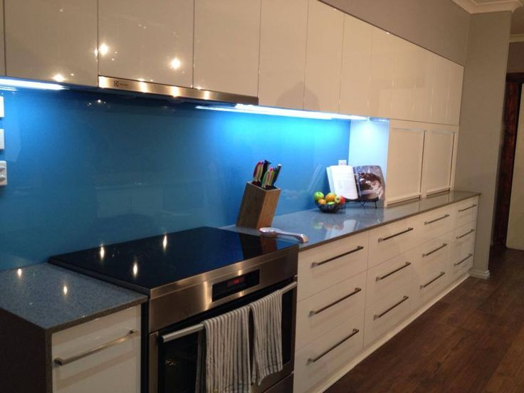 Silestone benchtop in galaxy and vinyl wrap gloss white doors