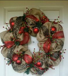 Christmas wreath with red, leopard burlap @Rose Englert what if we strung burlap and ribbon through ours?