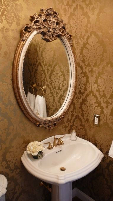 "Elegant little ""bronzy"" half-bath. It's simple, but so classy."