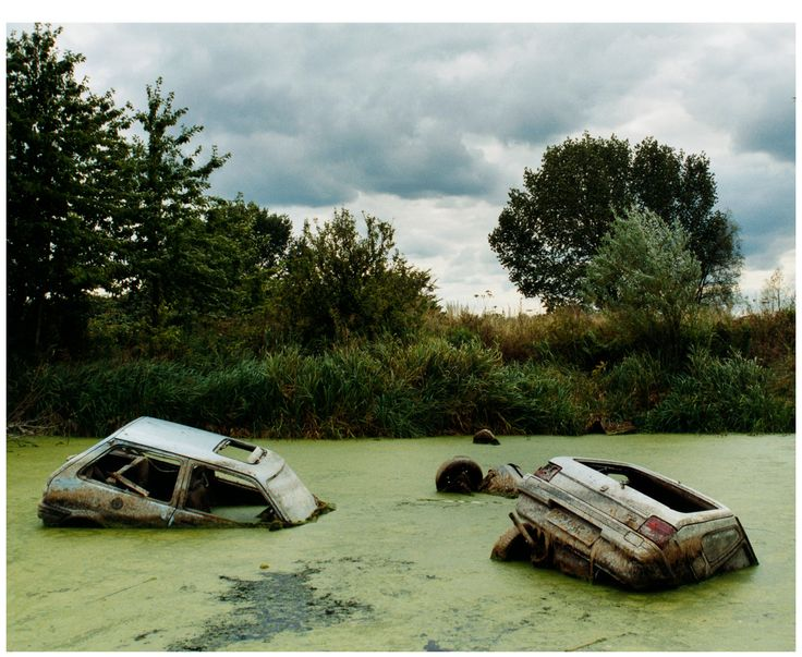 This photo by Ali Richards is from her 'Playground' series and focuses on the social workings of troubled teenagers through the depiction of abandoned cars. The photo looks rather peacefull as the cars just float and rest in the swamp like water, through the context of the photo adds a rather active story to the image