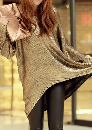 Metallic sweater with black pants and metallic clutch.