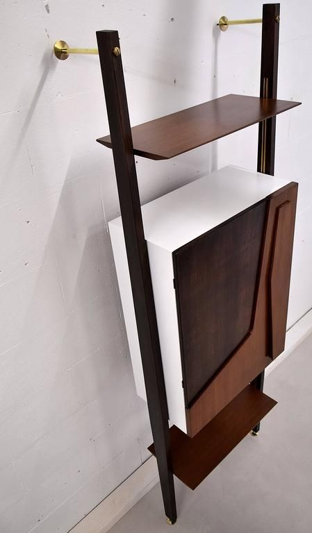 Italian Mid-Century Modern Dry Bar with Fold Out Bar Top. | From a unique collection of antique and modern dry bars at https://www.1stdibs.com/furniture/storage-case-pieces/dry-bars/