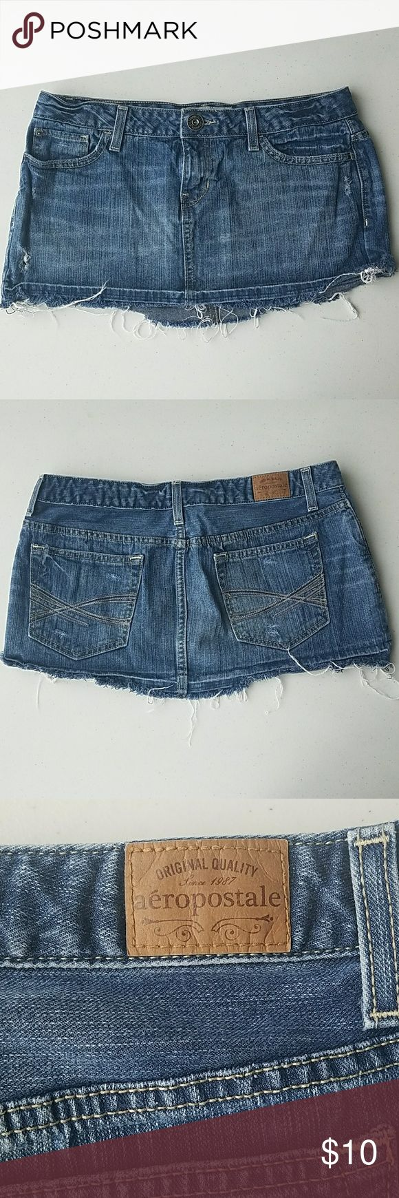 """Aeropostale distressed jean skirt Aeropostale distressed jean skirt.  Size 11/12. Approx waist 16.5"""", length 10.5"""". 100% cotton. Great condition! Holes and frilled ends are made for looks. Aeropostale Skirts Mini"""