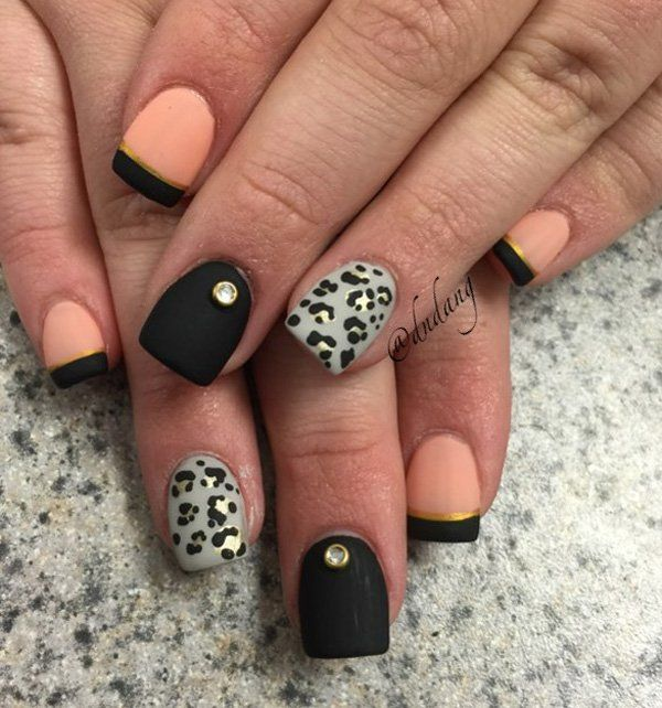 Black, melon and gray winter nail art. Prefect for just about any occasion. The nails are painted in matte black, melon and gray with leopard prints drawn on top as well as gold embellishments to complete the look.